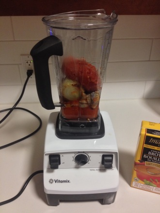 Into the Vitamix! (Notice my canned tomatoes I threw in to help fill out the flavor!)